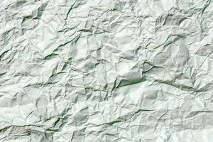 Crumpled paper background texture photo