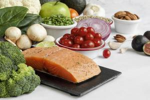 Salmon and whole foods on white background photo