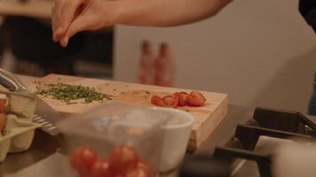 Hands of woman arranging food on kitchen counter video