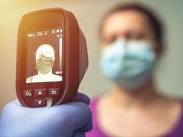 A thermal scanner for fever and symptoms of coronavirus photo