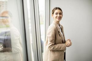 Woman standing in modern office photo