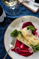 Cod in a beet sauce photo