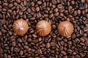 Chocolate candies and coffee photo