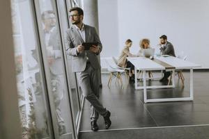 Businessman looking out window photo
