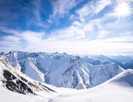 Gorgeous Panoramic view of white Caucasus mountains photo