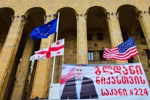 Tbilisi, Georgia - 9th April, 2021, Georgian and USA flags by the parliament photo