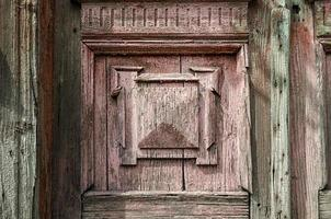 Old wooden wall of vintage house with decor photo