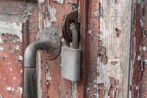 Old vintage lock on a wooden door photo