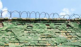 Barbed wire on blue sky background photo