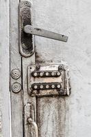 Old digital combination lock on an iron door photo