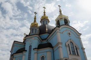 Golden domes of Christian church with crosses photo