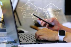 Person working on laptop computer and business analytics intelligence concept photo