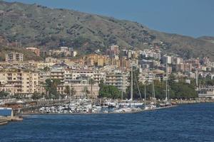 View of the Messinas port with the gold Madonna della Lettera statue in Sicily Italy photo