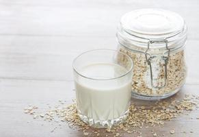 Vegan oat milk non dairy alternative milk photo