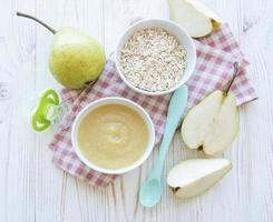 Bowl with fruit baby food and pears photo