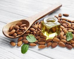 Almond oil and almonds photo