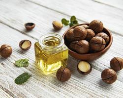 Natural macadamia oil and Macadamia nuts photo