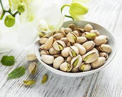 Bowl with pistachios photo
