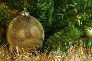 Christmas decoration with gold chain on the tree photo