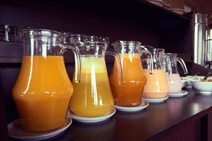 Jars with fresh juices and smoothies photo