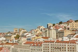 View of traditional architecture and houses on Sao Jorge hill in Lisbon Portugal photo