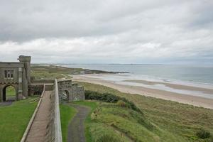 View of a beach from Bamburgh Castle in Northumberland England UK photo