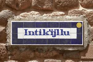 Street sign in the old town of cusco peru photo
