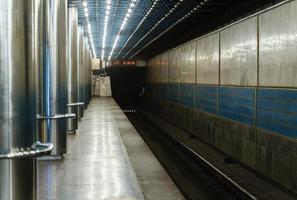 Empty subway station at night background photo
