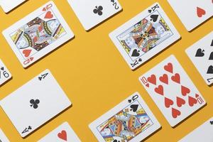 Casino cards on yellow background photo