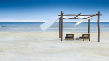 3ds rendered footage of blowing blind over the timber pavilion placed on the beach which have blue sky and sea as background video