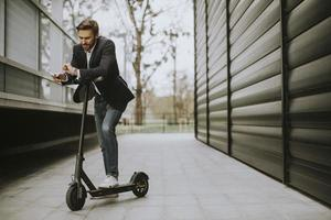 Man leaning on a scooter photo