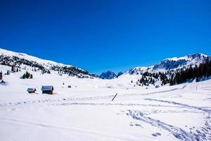 Snowy Dolomites and huts photo