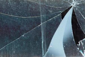 Fondo de vidrio roto de ventana agrietada concepto penal foto
