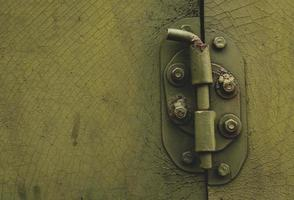Metal door with bolt in grungy style with copy space photo