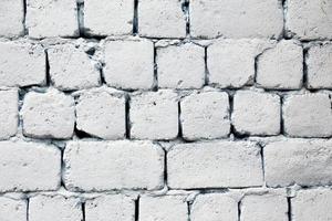 Primer plano de fondo de textura de pared de ladrillo blanco antiguo foto