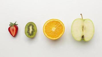Fresh fruits arrangement flat lay photo