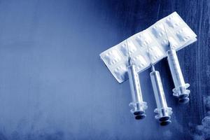 Close up image of a syringe photo