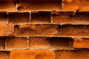 Primer plano de fondo de textura de pared de ladrillo rojo antiguo foto