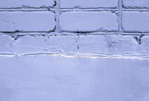 Primer plano de fondo de textura de pared de ladrillo antiguo púrpura foto