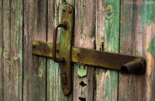Old wooden door with handle an old wooden door with cracked paint photo