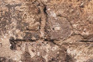 Primer plano de fondo de textura de pared de ladrillo marrón antiguo foto