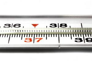 Thermometer closeup on white background photo