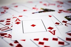 Red playing cards in chaos photo
