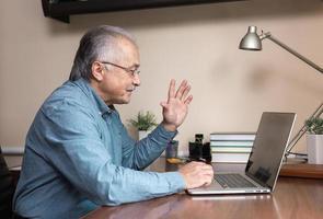Senior man uses online communication photo