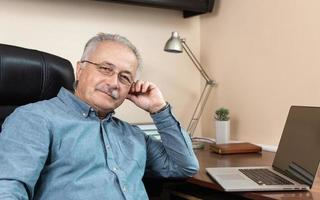 Senior businessman works at home photo