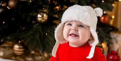 Christmas child laughs and shows tongue photo