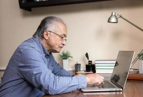 Senior man learn to use computer photo
