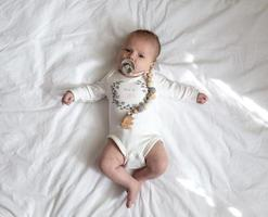Portrait of a newborn baby girl on a bed photo