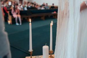 Small wedding table in white with candles and flowers photo