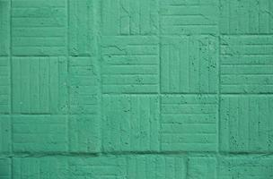 Decorative green painted wall with square and strips background texture photo